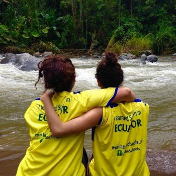 Students together seeing the river, Ecuador
