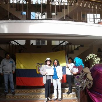 Students in front of flag of Ecuador
