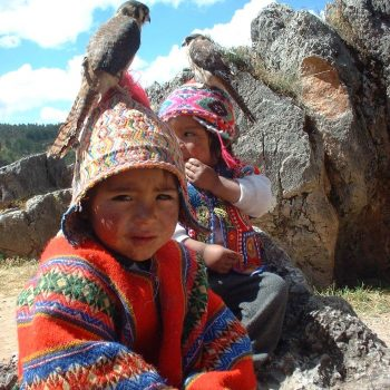 Kids with ponchos and birds, Cusco, Peru