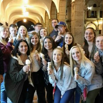 Students eating icecreams, Peru