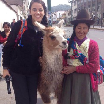 Student posing with an alpaca, Peru