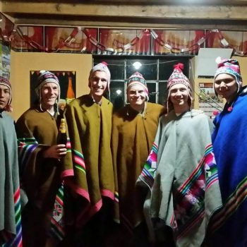 Students wearing ponchos, Peru