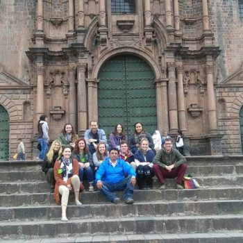 Students in front of a cathedral, Peru