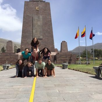 Students doing a pyramid in Ciudad Mitad del Mundo, Quito, Ecuador