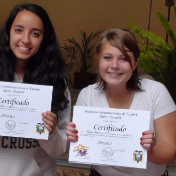 Two students with their certificates, Quito, Ecuador