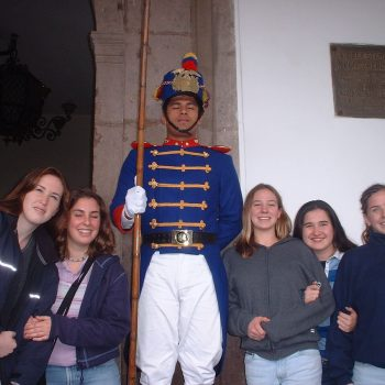 Students posing with a presidential guard, Quito, Ecuador
