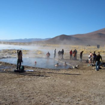 Students taking a bath in Termas de Polques, Bolivia
