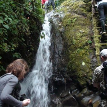 Students near a waterfall, Quito, Ecuador