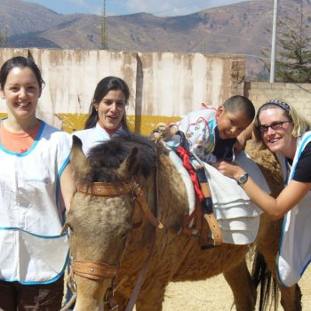 Volunteers with a horse and a kid, Quito, Ecuador
