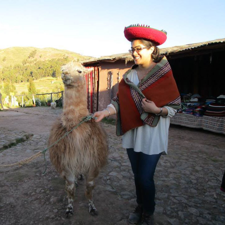 Student with an alpaca, Cusco, Peru