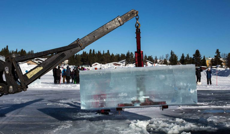 A crane lifting a block of ice